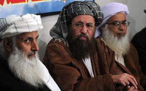 Taliban delegation members waiting to meet government negotiators in Islamabad.