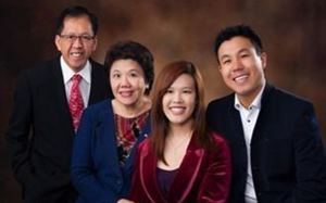 Parramatta shooting victim Curtis Cheng (left) with family.