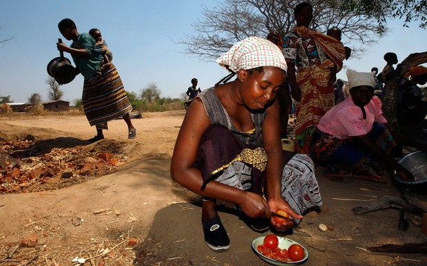 Villagers prepare food for a feast at the Nanthomba Primary School October 4, 2007 in Nanthomba, Malawi.