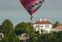 Hot air balloons float above Hamilton as part of Balloons Over Waikato 2010.