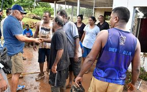 Fiji Prime Minister Frank Bainimarama visits a community in Ba which was hit by floods caused by Cyclone Josie.
