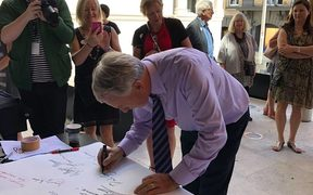 Auckland Mayor Phil Goff signing the Auckland Art Gallery Scroll