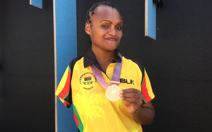 Friana Kwevira with her gold medal