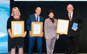 Gold Award winners Mandy Jackson, Joe Adam and Steve Orr with Dame Patsy Reddy.