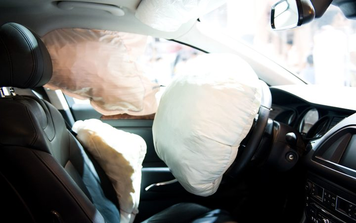 A stock photo of an air bag inflated after car crash.