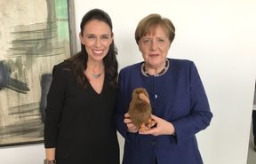 Jacinda Ardern and Angela Merkel with a kiwi soft toy.