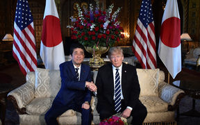 U.S. President Donald Trump (R) and Japan's Prime Minister Shinzo Abe hold a summit meeting at Mar-a-Lago in Palm Beach, Florida, U.S.A. on April 17, 2018.  ( The Yomiuri Shimbun )