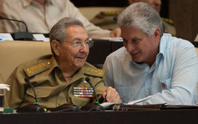 Raul Castro (L) talks with Miguel Diaz-Canel during the First Annual Session of the Cuban Parliament at the Convention Palace in Havana.