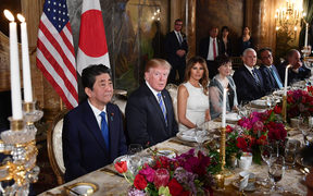 US President Donald Trump, First Lady Melania Trump, Japan's Prime Minister Shinzo Abe, and his wife Akie Abe take part in a dinner at Trump's Mar-a-Lago estate.