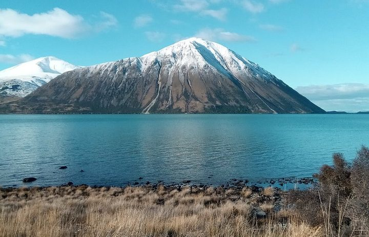 A view across Lake Ohau with a snowy peak in the background.