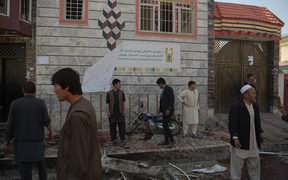 Afghan residents inspect the site of a suicide bombing outside a voter registration centre in Kabul on April 22, 2018