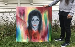 Roy Irwin with his unique painting of Michael Jackson.
