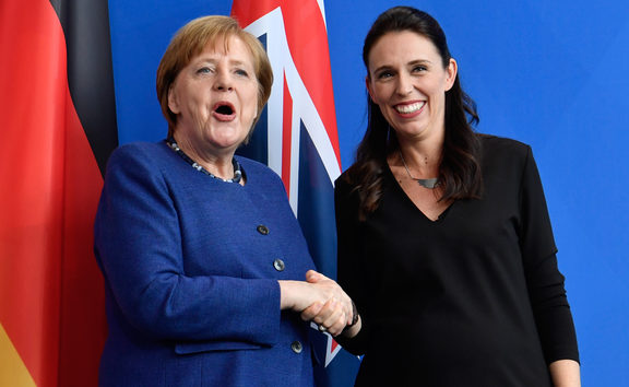 German Chancellor Angela Merkel shakes hands with Prime Minister Jacinda Ardern following a joint press conference on 17 April in Berlin.