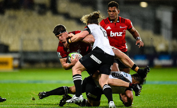 Scott Barrett of the Crusaders is tackled by Michael Little and Takuma Asahara of the Sunwolves during the Super Rugby match, Crusaders V Sunwolves,