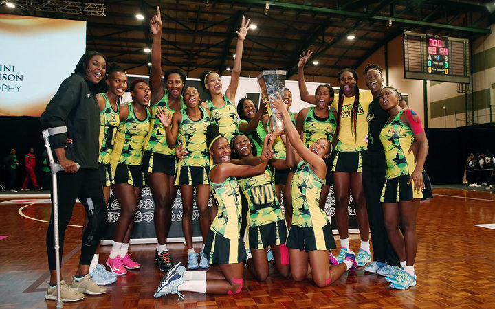 The Jamaica Sunshine Girls celebrate with the Taini Jamison Trophy after winning in the final. Taini Jamison Trophy, Final, New Zealand SIlver Ferns v Jamaica Sunshine Girls at North Shore Events Centre, Auckland, New Zealand. 24 March 2018 © Copyright Photo: Anthony Au-Yeung / www.photosport.nz