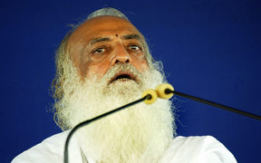 In this file photo taken on July 18, 2008 Indian spiritual leader Asaram Bapu addresses supporters at the sect's ashram (Spiritual Centre) on the outskirts of Ahmedabad.
