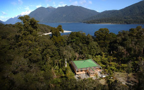 Aerial shot of Charlie Paterson's wilderness lodge at Jamestown on the shore of Lake McKerrow in the Hollyford Valley.