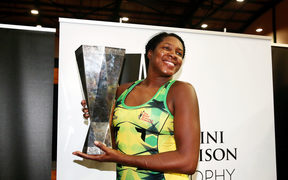 Jhaniele Fowler Reid of Jamaica celebrates with the Taini Jamison Trophy after winning the final against the Silver Ferns.