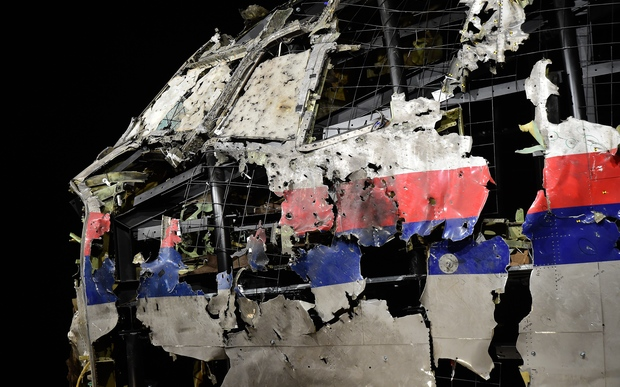 The wrecked cockipt of the Malaysia Airlines flight MH17 is exhibited during a presentation of the final report on the cause of the its crash at the Gilze-Rijen Air Base on 13 October 2015.
