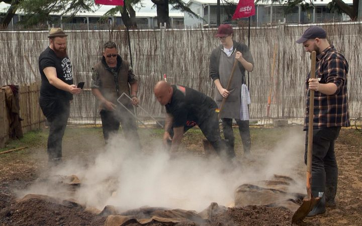 Rewi Spraggon guides chefs in the art of hangi making.