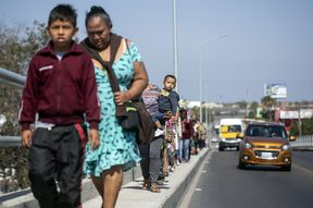 "Central American migrants travelling in the ""Migrant Via Crucis"" caravan walk to their legal counselling meeting in Tijuana, Baja California state, Mexico, on April 28, 2018."