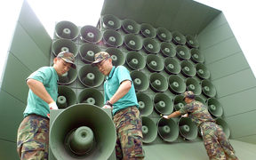 South Korean soldier tear down a battery of propaganda loudspeakers along the border with North Korea in Paju on 16 June 2004.