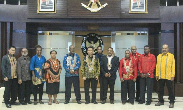 Members of a Solomon Islands delegation to Papua with Indonesian officials including Minister Wiranto in the middle