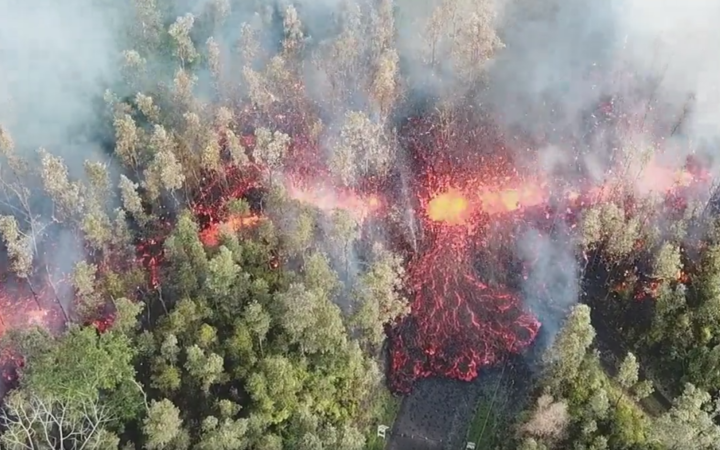 Still from drone footage of lava flow in Leilani Estates, Hawaii
