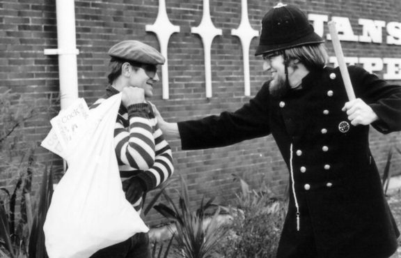 BLERTA actors Bruno Lawrence and Tony Barry ham it up in a keystone cops role, with the contents of the loot bag appearing to be copies of the controversial 70s underground magazine Cock.