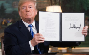 US President Donald Trump signs a document reinstating sanctions against Iran after announcing the US withdrawal from the Iran Nuclear deal.