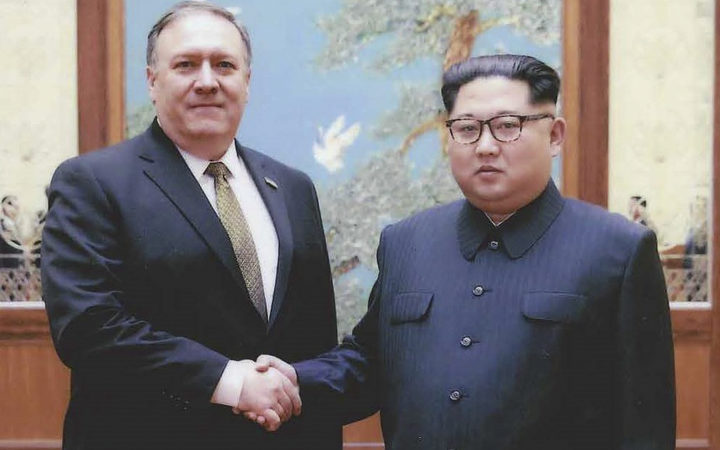 North Korean leader Kim Jong-Un shakes hands with US Secretary of State Mike Pompeo.