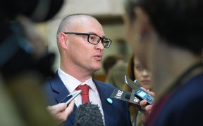 Minister of Health David Clark talking with journalists