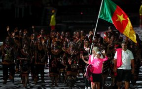 Cameroon's flagbearer Essiane Clotilde leads the delegation during the opening ceremony of the 2018 Gold Coast Commonwealth Games at the Carrara Stadium on the Gold Coast on April 4, 2018.