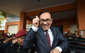 Jailed former opposition leader and current Federal opposition leader Anwar Ibrahim greets supporters after his released from the Cheras Hospital Rehabilitation in Kuala Lumpur on May 16, 2018.
