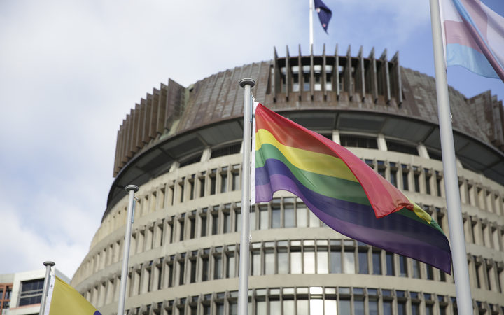Rainbow flag flies outside Parliament.