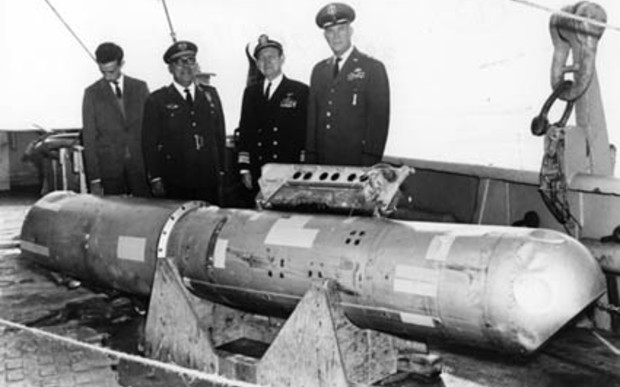 The B28RI nuclear bomb, recovered from 2,850 feet (870 m) of water, on the deck of the USS Petrel.