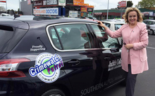 Judith Collins with the car she has been given for six months by a South Auckland company.