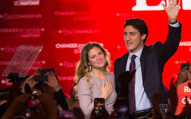 Canadian Liberal Party leader Justin Trudeau and his wife Sophie wave on stage in Montreal on 20 October 2015 after winning the general election.