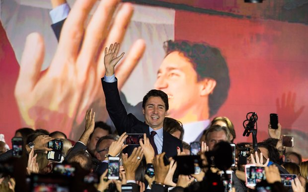 Canadian Liberal Party leader Justin Trudeau arrives on stage in Montreal on October 20, 2015 after winning the general elections.