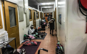 Patients wait along a corridor in the triage area of the National Referral Hospital in Solomon Islands.