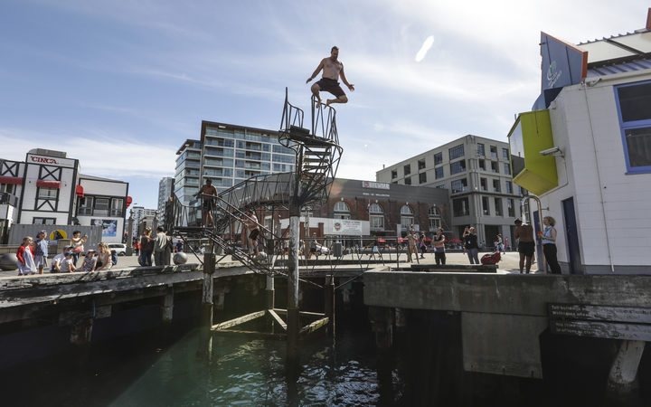 Summer in Wellington, people jump into the harbour.
