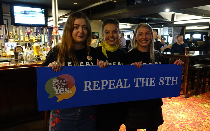 Heather Byrne (left), Eimear Connolly (middle) and another Irish yes supporter in Wellington on Saturday night.