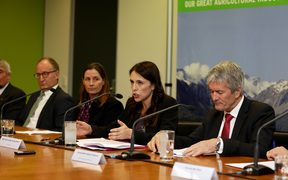 Prime Minister Jacinda Ardern, centre, announces the government's decision to attempt to eradicate the cattle disease