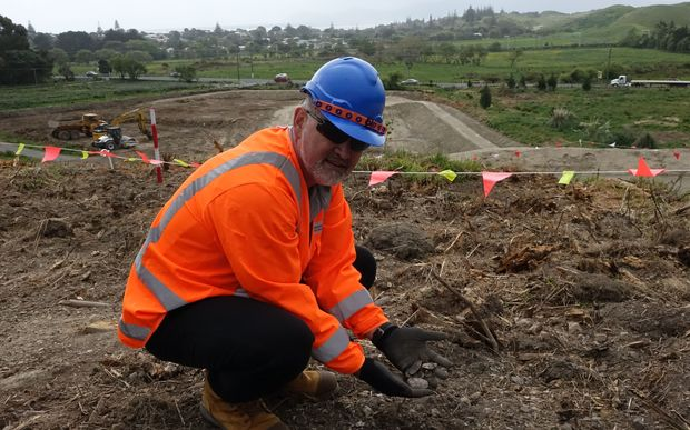 Environmental advisor Reuben Mills at midden site