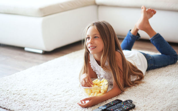 A child eating while watching TV