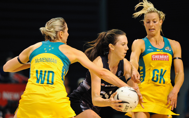 Bailey Mes of the Silver Ferns is tackled by Clare McMeniman of the Diamonds and Laura Geitz of the Diamonds during the Constellation Cup Netball match, Silver Ferns v Australia, in Christchurch, on the 20th October 2015.