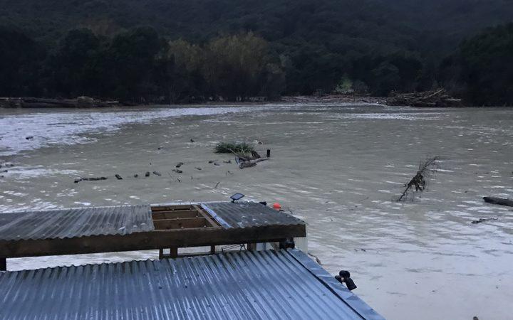 The Uawa river in flood at Tolaga Bay.