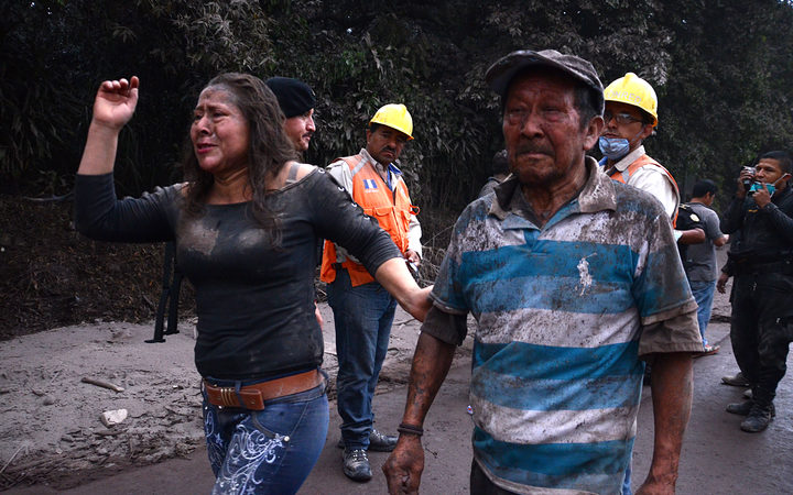 Guatemala volcano death toll soars as rescuers search mud and ash