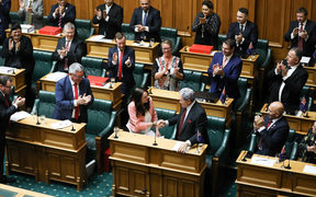 Prime Minister Jacinda Ardern shakes hands with Deputy Prime Minister Winston Peters at the end of her speech in the Budget 2018 debate.