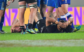 France's Remy Grosso (L) lays on the ground after running into All Blacks Ofa Tu'ungafasi (R  during the Steinlager Series rugby match between the All Blacks and France at the Eden Park in Auckland on Saturday the 9th of June 2018. Copyright Photo by Marty Melville / www.Photosport.nz